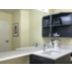 Well lit, spacious guest bathrooms with granite counter tops.