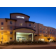 Hotel Exterior featuring a well lighted exterior