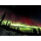 Northern Lights fill the sky near the Candlewood Suites Fairbanks