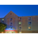 The Candlewood Suites Extended Stay Hotel Front Entrance at Dusk