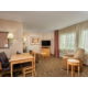 Enjoy the living area of our larger king suite