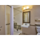 ADA Accessible Bathroom featuring a Roll-in Shower