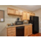 Enjoy a home cooked meal in our King Studio Suite Kitchen