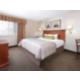 One Bedroom King Suite bedroom