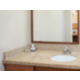 Guest bathrooms are well lit with granite counter tops.