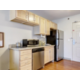 Kitchen with refrigerator, microwave and dishwasher in each suite