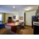 One Bedroom Queen Suite Living Area and Kitchen