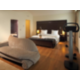 Suite's kingsize bedroom, featuring fitness bike