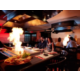 Book a teppanyaki table and experience authentic Japanese dining