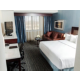 King Bed Guest Room with Sofa Sleeper and refrigerator