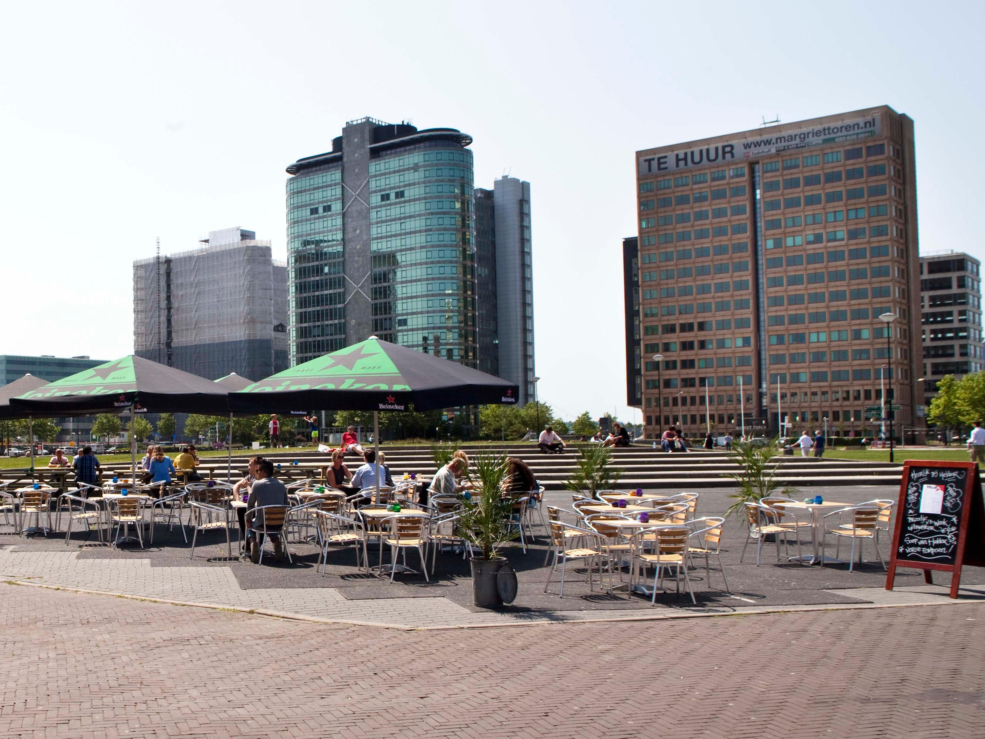Enjoy a drink or some food before a concert on a terrace.