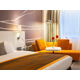Executive room with king size bed relaxing sofa and flatscreen tv