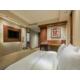 A relaxing standart queen bed guest room