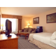 Two Room Junior Suite with King bed, Murphy bed, and sleeper sofa