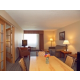 Living Room with Dining Table, Fridge, Microwave, and Sleeper Sofa
