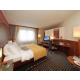 Spacious Business Suite with complimentary mini-bar soft drinks