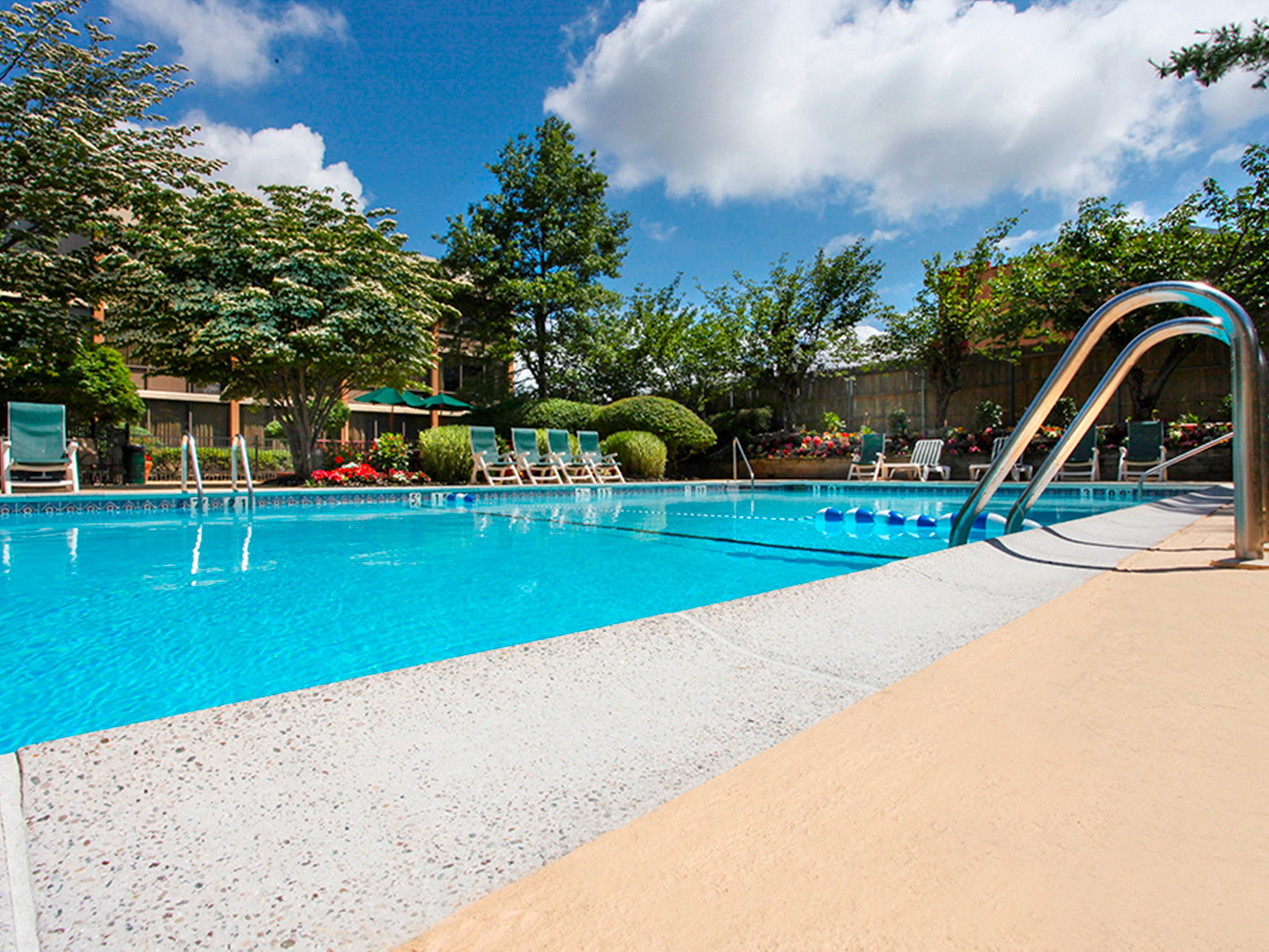 Take a dip in our outdoor swimming pool to cool off