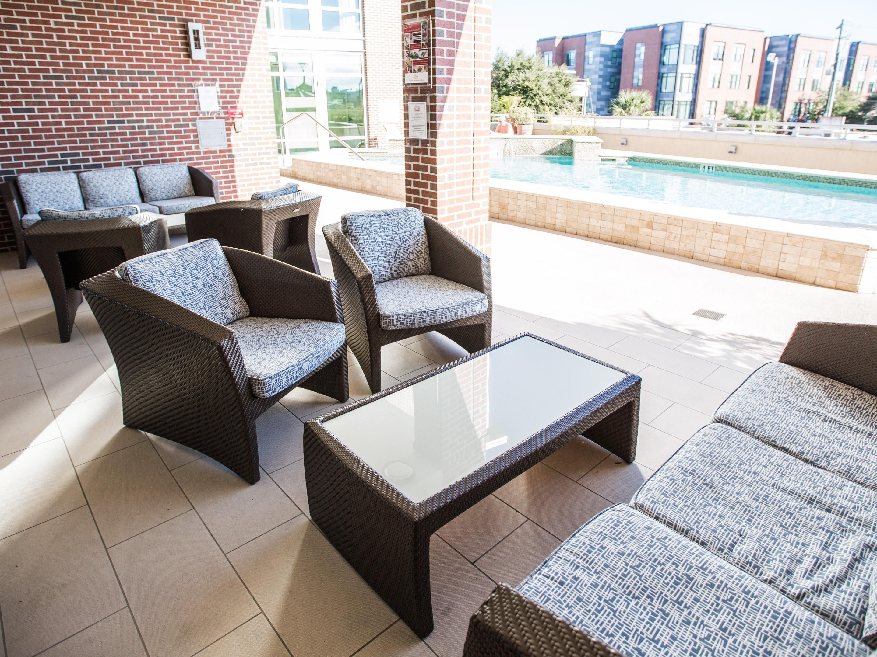 Enjoy our Covered Patio, Ceiling Fans & LIving Room Style Seating