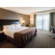 Feature room with king bed, private balcony and chairs