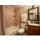 Private bathroom with shower-tub combination