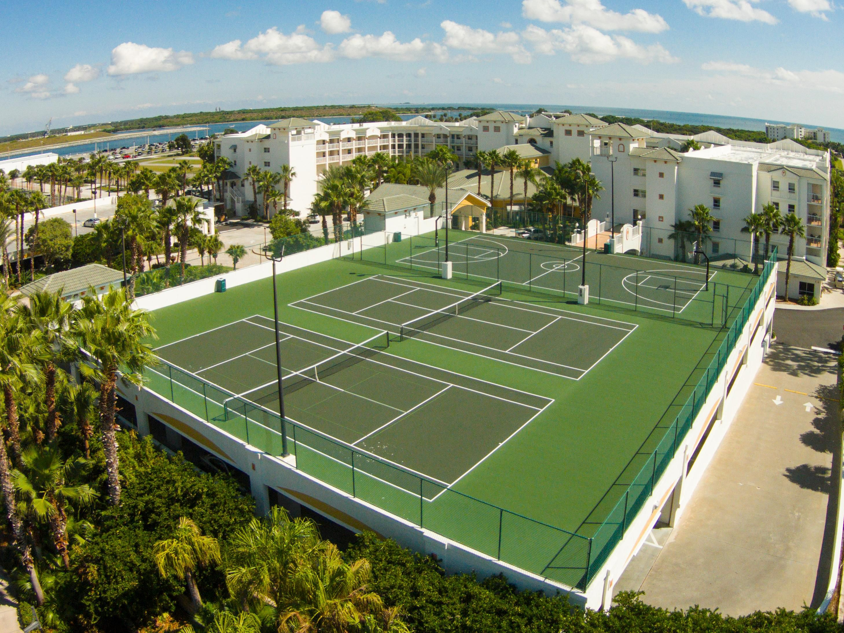 Challenge friends to a game of tennis or basketball on the courts