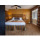 Beautifully decorated master bedroom with king size bed