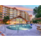 Beautiful outdoor pools and hot tub for guests to relax in