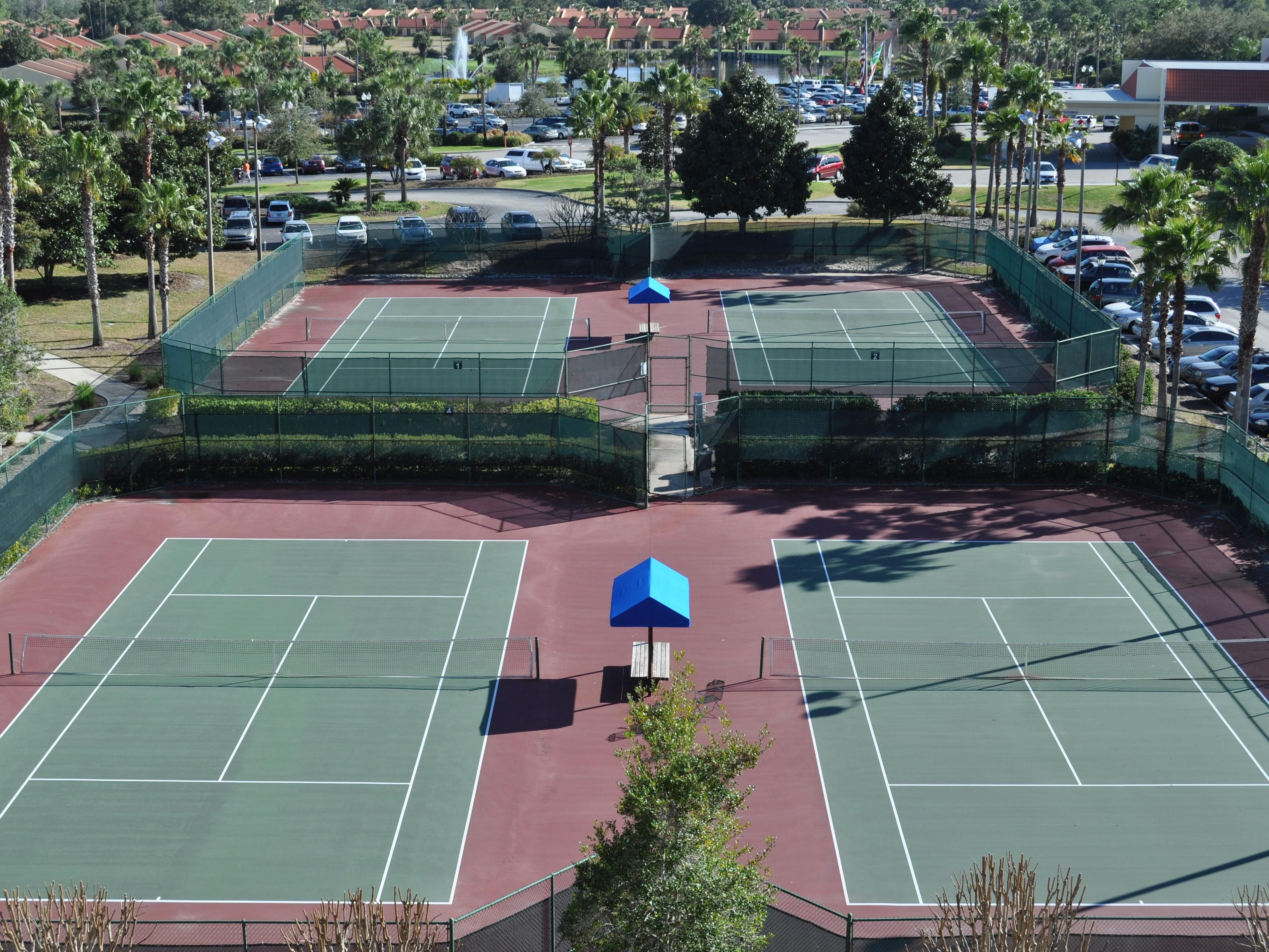 Enjoy a game of tennis with friends and family