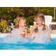 Kids having fun splashing in pool