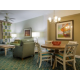 Enjoy separate dining area and living room w/ pullout sofa and TV