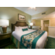 Beautiful master bedroom with king size bed, TV and private bath