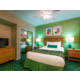 Queen size bed with private bathroom and TV
