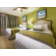 Relax in luxury in Signature Collection suite with 2 double beds