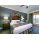 Signature Collection bedroom with king size bed and upscale linens