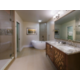 Signature Collection bathroom with ornate separate tub