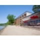 700' of Sandy beach with patio seating for dining