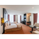Stay relaxed in twin bed Deluxe room