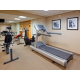 Fitness Center with cardio equipment, free weights, and sauna