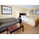 King Bed Guest Rooms feature Sofa Beds and Flat Screen HD TVs