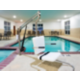 Relaxing indoor pool and whirlpool with accessible lift