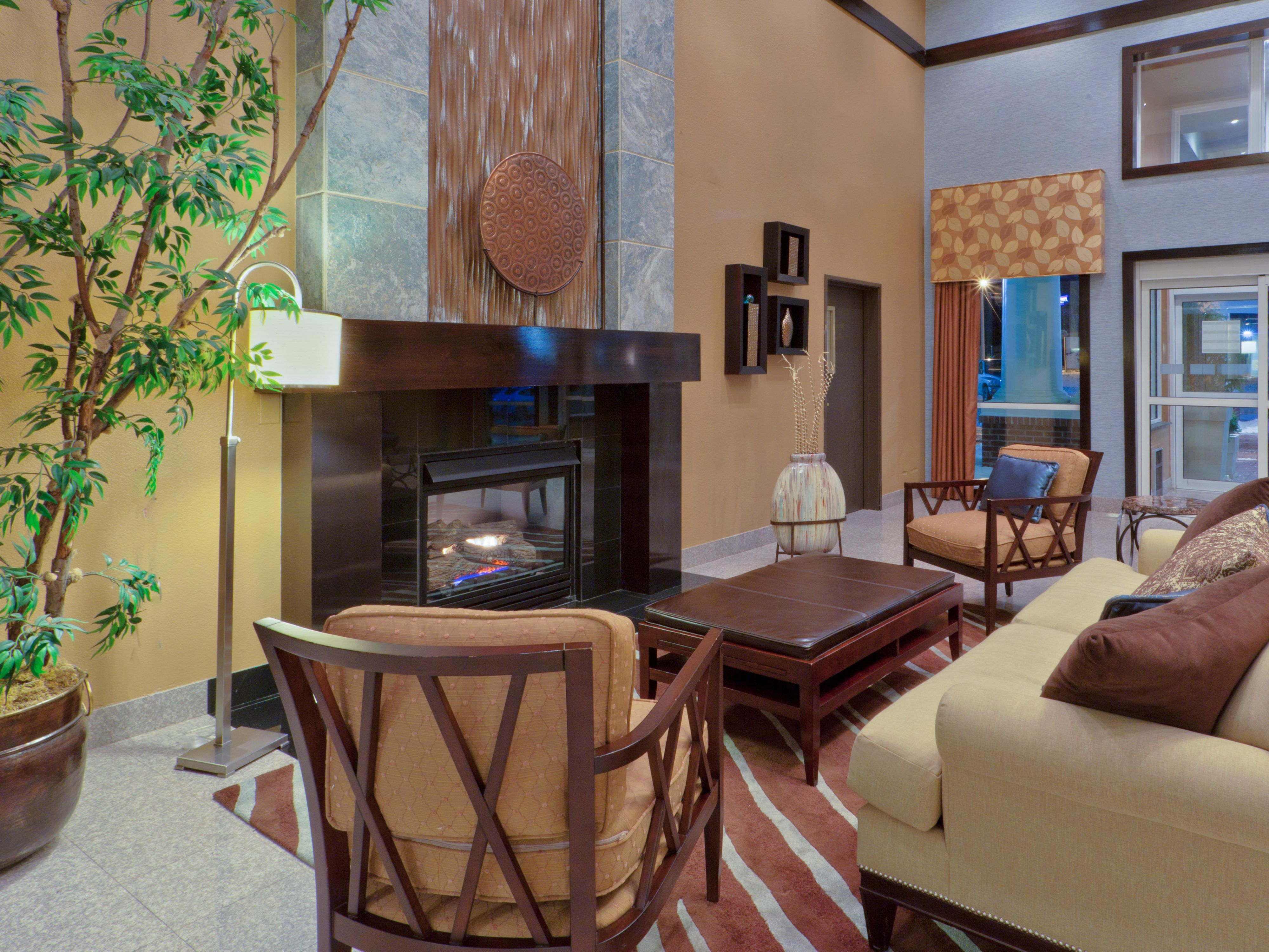 Have a seat in front of our warm and cozy fireplace.