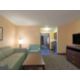 Enjoy the convenience of the living area in our two room suites.