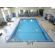 Swimming Pool with lounge chairs, showers and bathrooms