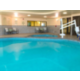 Our Pool area features dual showers and relaxing lounge chairs