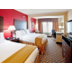 Queen Bed Guest Rooms include workspace, lounge chair and ottoman