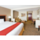 King Suites Feature A King Bed With A Small Sofa-Sleeper