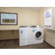 24 hour coin operated laundry facility.