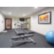 24 hour fitness center with yoga ball, weight bench, and more.