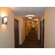 Well-lit guest floor hallway