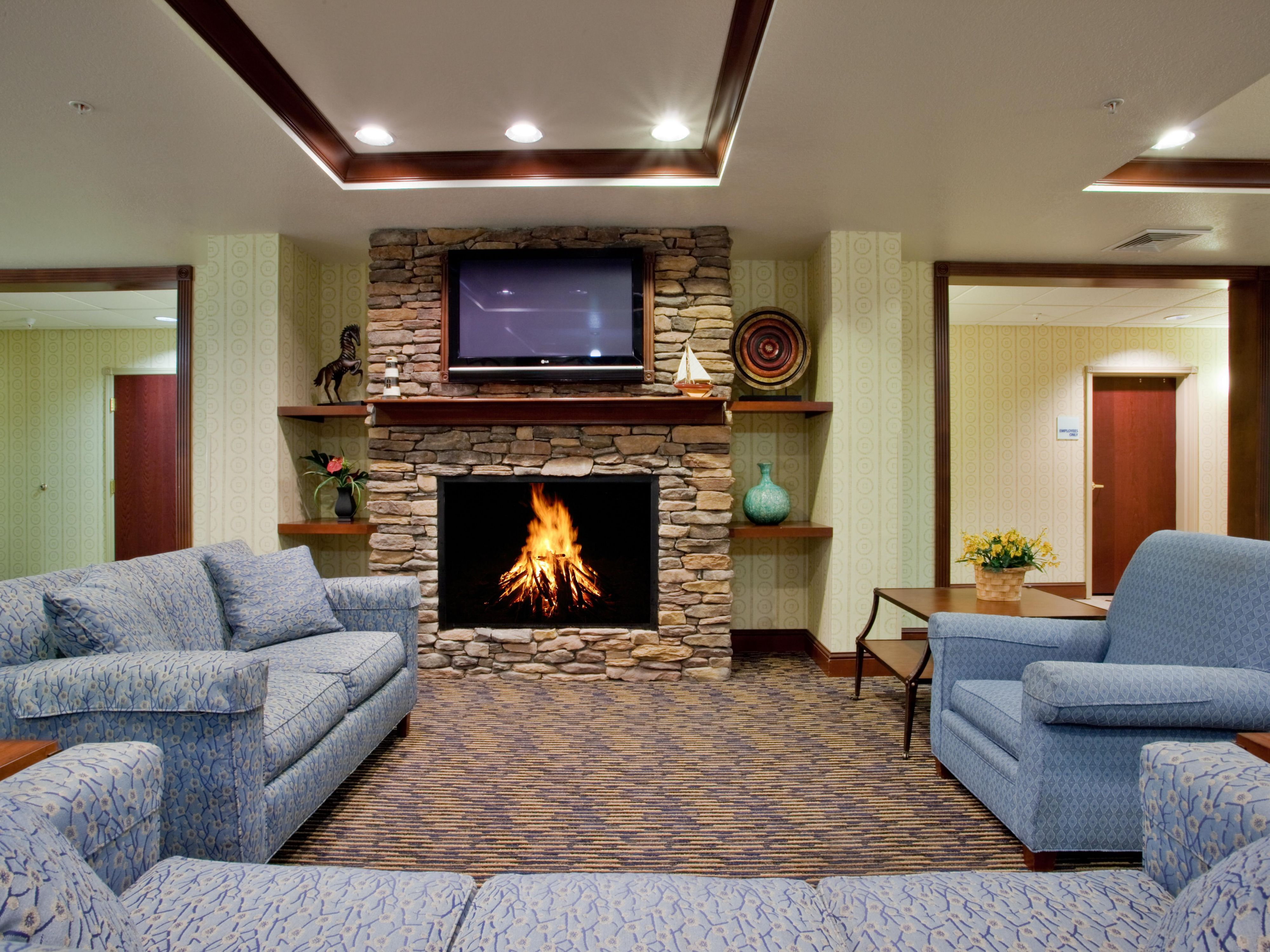 Relax, Watch TV in our great room and keep warm with a cozy fire.